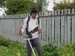Young person using the strimmer