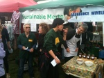 Volunteers tasting the jam at the stall
